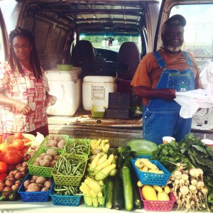 Vendors sell their vegetables at Crescent City Farmer's Market. Photo courtesy of CCFM.